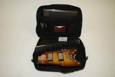 Tobacco_Sunburst_professional_electric_travel_guitar_in_computer_bag_op_800x535.jpg