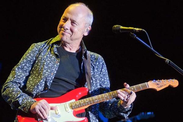 """Esto es lo que ocurriría si 12 famosos guitarristas tocasen """"Sultans Of Swing"""""""
